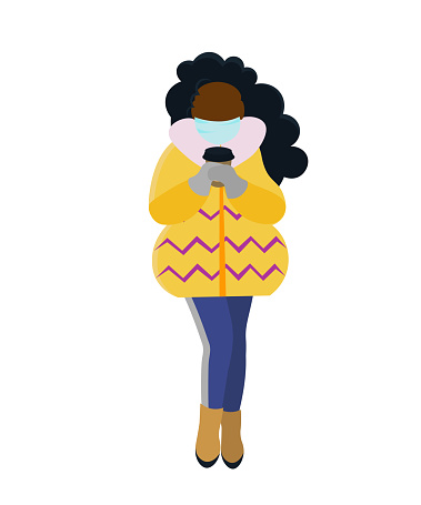 African woman wearing protection mask and drinking coffee.