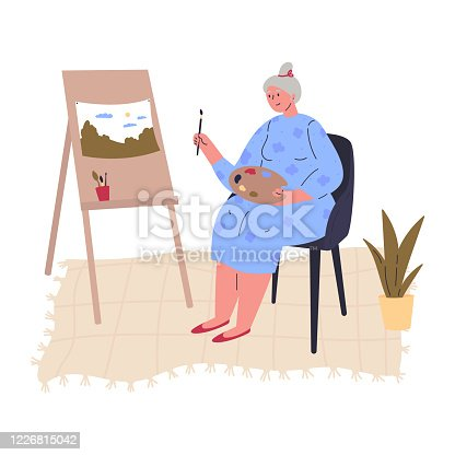 istock Aged creative woman is drawing a picture at easel 1226815042
