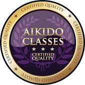 Aikido classes gold emblem with a laurel.