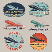 Set of aircraft and air transportation vector labels.Logo templates,badges,emblems,signs color graphic collection.Air voyage,tour,flight promotion and advertising symbols isolated on grey background