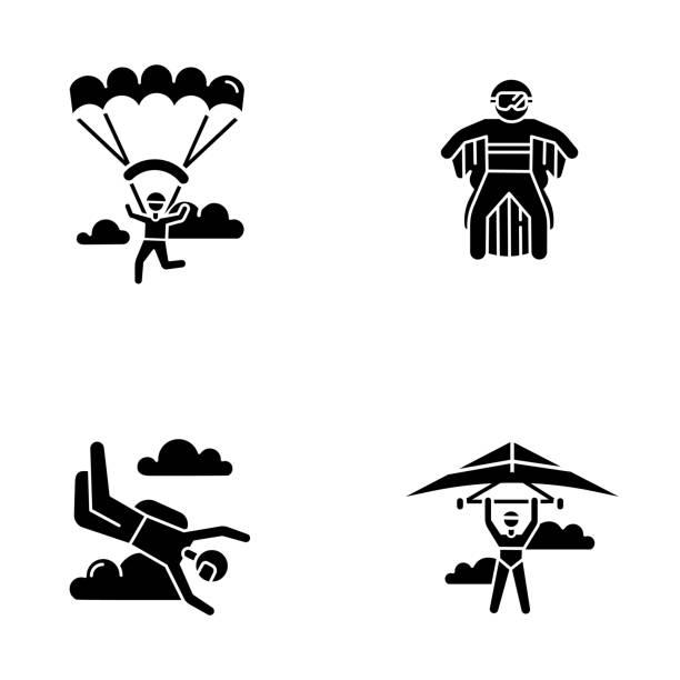 ilustrações, clipart, desenhos animados e ícones de ícones de glifo de esportes radicais no ar definidos. asa delta, paraquedismo, roupa de asa e parapente. atividades ao ar livre. entretenimento de adrenalina e recreação arriscada. ilustração isolada do vetor de silhueta - ícones de design planar