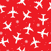 Vector illustration of airplanes and snowflakes in a repeating pattern against a red background.