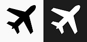 Airplane Icon on Black and White Vector Backgrounds. This vector illustration includes two variations of the icon one in black on a light background on the left and another version in white on a dark background positioned on the right. The vector icon is simple yet elegant and can be used in a variety of ways including website or mobile application icon. This royalty free image is 100% vector based and all design elements can be scaled to any size.