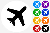Airplane Icon on Flat Color Circle Buttons. This 100% royalty free vector illustration features the main icon pictured in black inside a white circle. The alternative color options in blue, green, yellow, red, purple, indigo, orange and black are on the right of the icon and are arranged in two vertical columns.