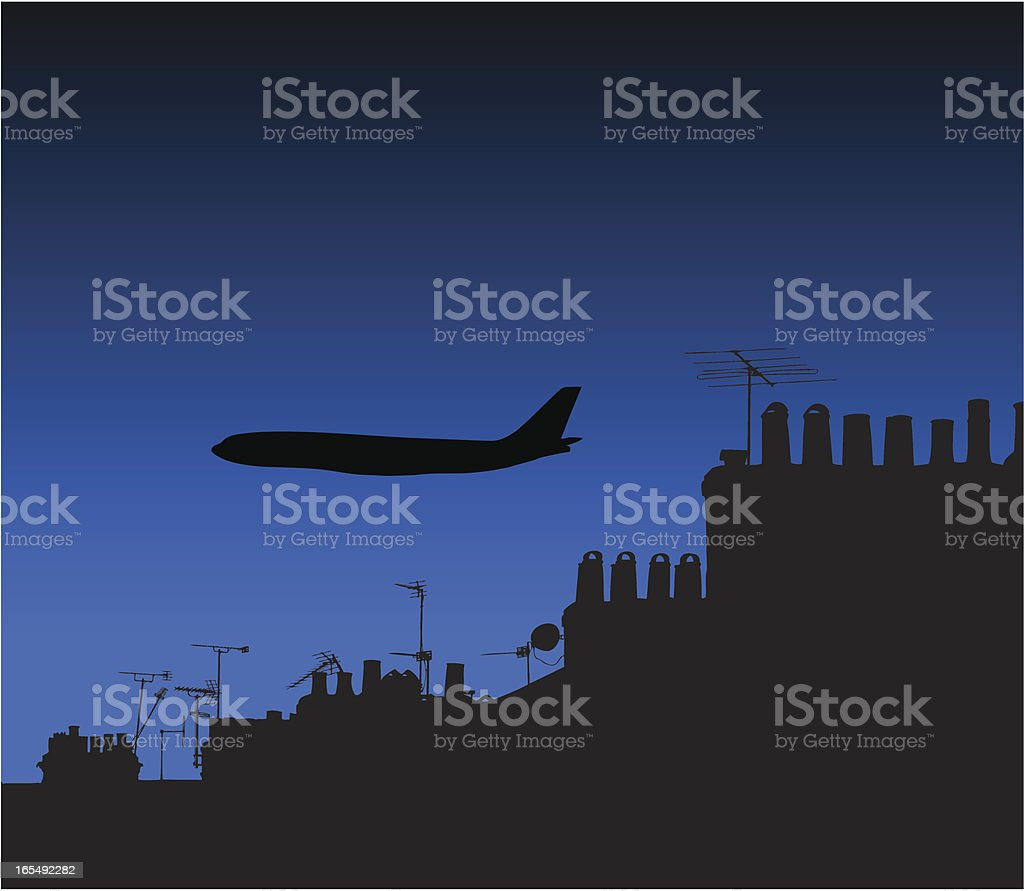 Airplane silhouette at night over houses royalty-free stock vector art