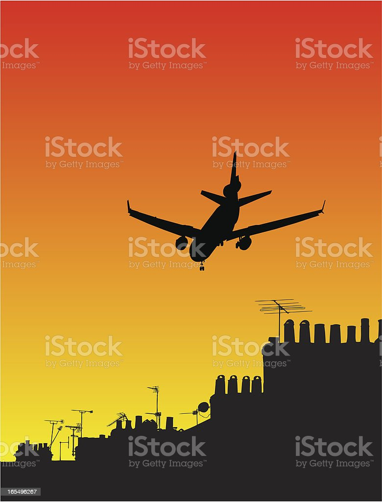 Airplane silhouette at sunset over rooftops vector art illustration