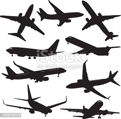 Vector silhouettes of nine commercial airplanes.