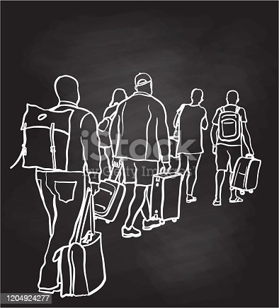 A group of people travelling to their gates at an airport