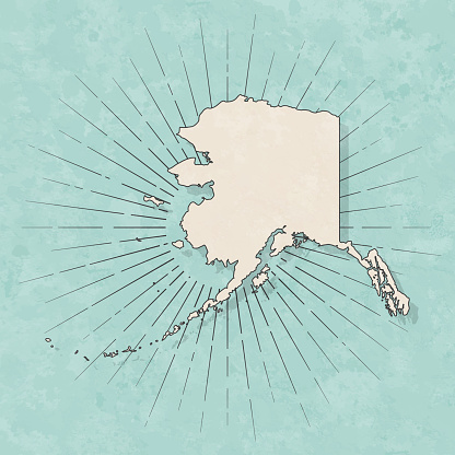 Map of Alaska in a trendy vintage style. Beautiful retro illustration with old textured paper and light rays in the background (colors used: blue, green, beige and black for the outline). Vector Illustration (EPS10, well layered and grouped). Easy to edit, manipulate, resize or colorize.