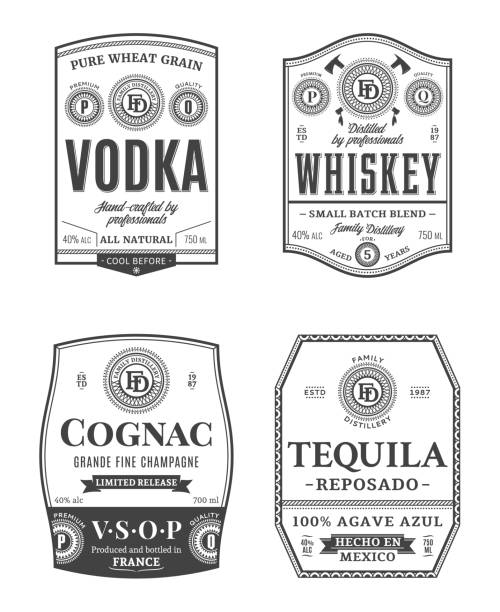 Alcoholic drinks vintage labels Alcoholic drinks vintage labels and packaging design templates. Vodka, whiskey, cognac and tequila labels. Distilling business branding and identity design elements. label stock illustrations