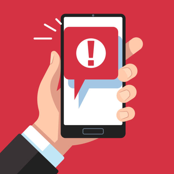 Alert message mobile notification. Hand holding smartphone with exclamation sign, virus notification on phone screen vector concept Alert message mobile notification. Hand holding smartphone with exclamation sign, virus notification on phone screen vector red error or spam messaging device prevention concept mobile advertisement stock illustrations