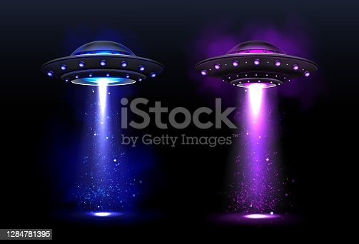 istock Alien spaceships, ufo with color light beam 1284781395