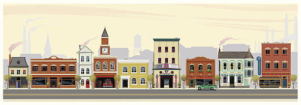 Along Main Street An illustrated depiction of shops, restaurants, stores and businesses along a main street in rural America. The scene in set in early fall with cool morning air, smoke stacks, church, water tower and suspended bridge in the background. In the foreground are (from left to right) a mansard roofed business, early american storefront, tall business-dwelling, firestation with clock tower, city hall, art deco movie theater, another storefront followed by a victorian restaurant and a drugstore. americana stock illustrations