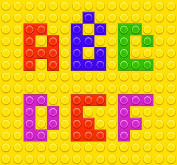 stockillustraties, clipart, cartoons en iconen met alphabet blocks created out of lego pieces - lego