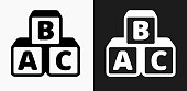Alphabet Blocks Icon on Black and White Vector Backgrounds. This vector illustration includes two variations of the icon one in black on a light background on the left and another version in white on a dark background positioned on the right. The vector icon is simple yet elegant and can be used in a variety of ways including website or mobile application icon. This royalty free image is 100% vector based and all design elements can be scaled to any size.