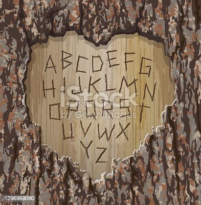 istock Alphabet letters carved into an old tree with heart shape cut out. 1296969080