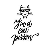 I am a cat person - hand written typography. Lettering sign. Funny handdrawn Inscription for t shirts, posters, cards. Vector illustration.