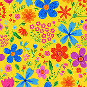 Amazing floral vector seamless pattern of bright colorful flowers in cute vintage style.Beautiful colorful flowers background. Spring primitive texture. Design folk style concept for fashion print.