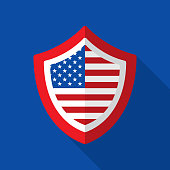 Vector illustration of an American flag on a shield against a blue background in flat style.