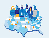 Team of business men and women in front of the United States map