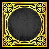 An abstract cube with gold fancy accents and black circle