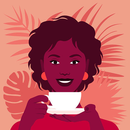 An African woman is holding a cup of tea or coffee. Happy breakfast.
