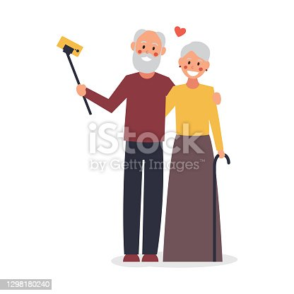 istock An elderly couple takes a selfie. Old people using modern technology. Elderly man and woman smiling and taking selfie using smartphone. Vector illustration. Character flat design 1298180240