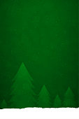 A horizontal vector illustration in dark green colour with different sized tall trees over a  snowing backdrop. Apt for use as Xmas wallpaper, poster, gift wrapping paper sheets, posters and Greeting Cards.