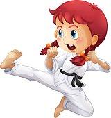 An energetic little girl doing karate