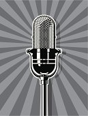 An illustration of a microphone in black and white