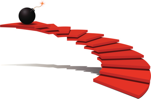 An illustration of a red staircase and a black bomb at top