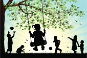 Vector illustration silhouettes of children playing in the park.  Hi-res jpg included