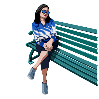 An Indian woman resting on a park bench.