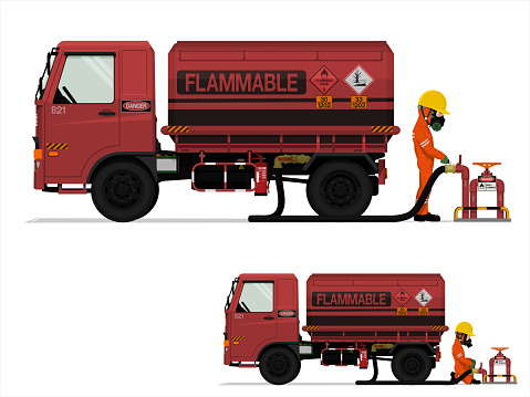 An industrial worker is loading flammable liquid on white background