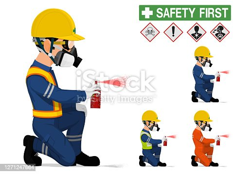 An industrial worker with respirator is spraying color