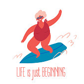 An old woman surfer stays active, riding, surfing on the summer vacations at sea. Happy aged woman enjoys life. Active lifestyle in elder age. life is just beginning text.