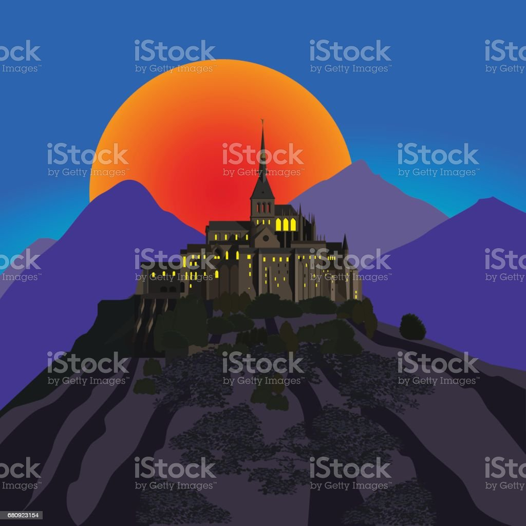 Ancient castle in mountains at sunset