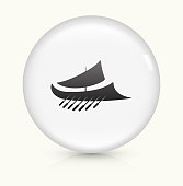 Ancient Roman Ship Icon on simple white round button. This 100% royalty free vector button is circular in shape and the icon is the primary subject of the composition. There is a slight reflection visible at the bottom.