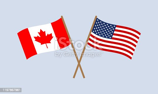 istock US and Canada crossed flags on stick. American and Canadian national symbols. Vector illustration. 1197867961