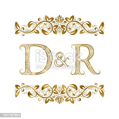 D and R vintage initials symbol. The letters are surrounded by ornamental elements. Wedding or business partners monogram in royal style.