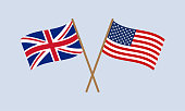 istock UK and US crossed flags on stick. American and British national symbol. Vector illustration. 1197867964