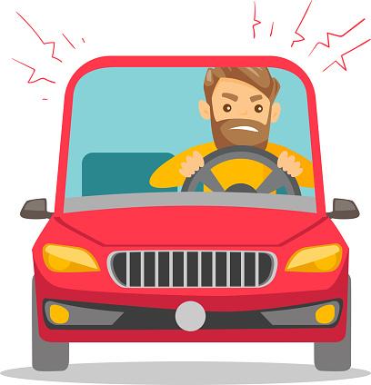 Angry caucasian man in car stuck in traffic jam