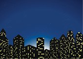 Illustration of city buildings at night.