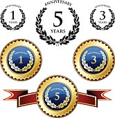 Anniversary trophies and seals with laurels.