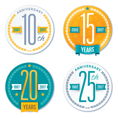 Anniversary badge symbols and design elements. Includes badges for 10, 15, 20 and 25 year annivesaries. EPS 10 file. Transparency effects used on highlight elements.