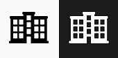 Apartment Building Icon on Black and White Vector Backgrounds. This vector illustration includes two variations of the icon one in black on a light background on the left and another version in white on a dark background positioned on the right. The vector icon is simple yet elegant and can be used in a variety of ways including website or mobile application icon. This royalty free image is 100% vector based and all design elements can be scaled to any size.
