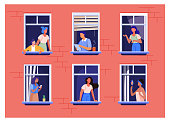 istock Apartment building with people in open window spaces 1205805919