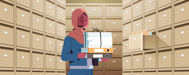 arab businesswoman holding cardboard box with documents in filing wall cabinet with open drawer data archive storage