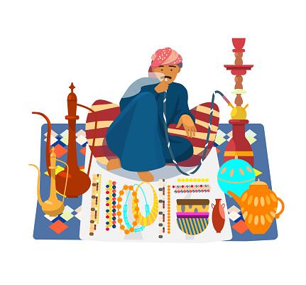 arab man smoking hookah and selling traditional souvenirs