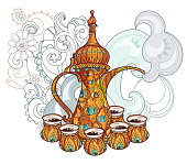 Arabic coffee maker dalla with cups.